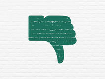 Social media concept: Thumb Down on wall background Royalty Free Stock Photo