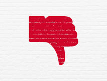 Social media concept: Thumb Down on wall background Stock Photography