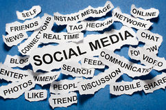 Social media concept torn newspaper headlines Stock Image