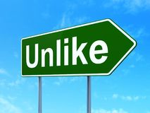 Social media concept: Unlike on road sign background. Social media concept: Unlike on green road highway sign, clear blue sky background, 3D rendering Royalty Free Stock Photo