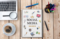 Social Media Concept On Work Desk With Various Doodle Icons Royalty Free Stock Images