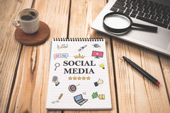 Social Media Concept On Work Desk With Various Doodle Icons Stock Image