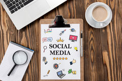 Social Media Concept On Work Desk With Various Doodle Icons Stock Photos