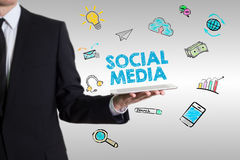 Social Media concept  with young man holding a tablet computer Stock Image