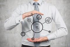 Social media diagram. Businessman holding social media diagram on gray background Royalty Free Stock Photography