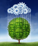 Social Media Growth. Technology concept with a tree shaped as a group of human heads growing helped by a virtual server cloud made of gears and cogs raining Royalty Free Stock Image
