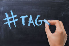 Social media hashtag on blackboard. With chalk Stock Photography