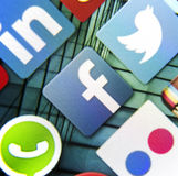 Social media icon Facebook on smart phone screen Stock Photo
