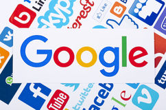 Social media icon. Google largest Internet search engine logo printed on paper and placed on of social media background..Google it is the largest Internet search royalty free illustration