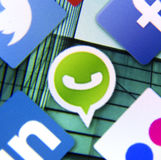 Social media icon Whatsapp on smart phone screen Royalty Free Stock Image