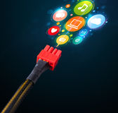 Social media icons coming out of electric cable Stock Photography