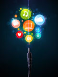 Social media icons coming out of electric cable Royalty Free Stock Photos