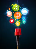 Social media icons coming out of electric cable Royalty Free Stock Image