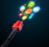 Social media icons coming out of electric cable Royalty Free Stock Photo