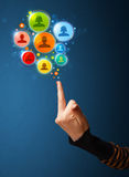 Social media icons coming out of gun shaped hand. Social media concept Stock Image