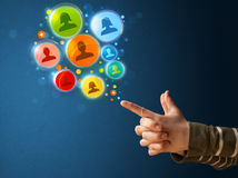 Social media icons coming out of gun shaped hand, Royalty Free Stock Images