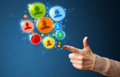Social media icons coming out of gun shaped hand Royalty Free Stock Images