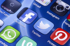 Social media icons Facebook, Twitter and other on smart phone screen close up Stock Images