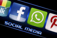 Social media icons Facebook and Whatsapp on smart phone screen close up Stock Photo