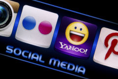 Social media icons Flickr and Yahoo on smart phone screen close up Royalty Free Stock Photography