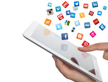 Social media icons fly off the ipad in hand Stock Photo