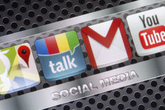 Social media icons Google talk, google mail and other on smart phone screen close up Royalty Free Stock Photography