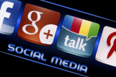 Social media icons Google Talk and Google plus on smart phone screen close up Royalty Free Stock Photography