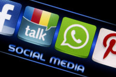 Social media icons Google talk and Whatsapp on smart phone screen close up Stock Image