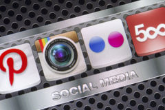 Social media icons Instagram Flickr and other on smart phone screen close up. BELGRADE - AUGUST 30, 2014 Social media icons Instagram Flickr and other on smart Royalty Free Stock Image