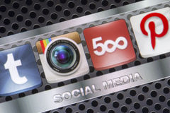 Social media icons Instagram 500px  and other on smart phone screen close up Stock Photography