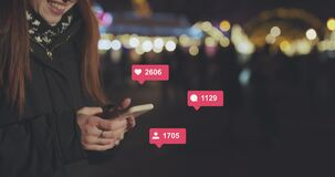 Woman Hands using Mobile Phone in the City at Night. Young Woman Texting, Communicating on Cellphone Outdoors. Social stock video footage