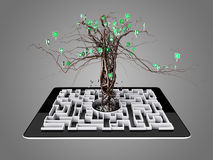Social media icons set in tree shape on Maze in the tablet. Stock Photos