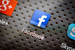 Social media icons on smart phone screen. Stock Photo