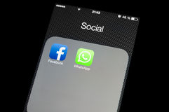 Social media icons on smartphone screen. Facebook buys WhatsApp - social media icons on smartphone screen stock photo