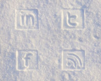 Social Media Icons in Snow. Twitter FacBook Linkedin and RSS Stock Photos