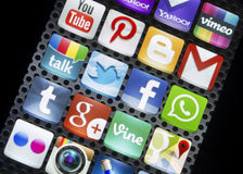 Social media icons Twitter, Facebook and other on smart phone screen close up Royalty Free Stock Photos