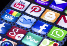 Social media icons Twitter, Facebook and other on smart phone screen close up stock photography