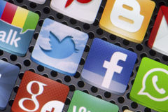 Social media icons Twitter, Facebook and other on smart phone screen close up Stock Image