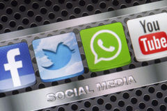 Social media icons Twitter, Whatsapp, Facebook, and Youtube on smart phone screen close up Royalty Free Stock Images
