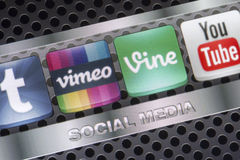 Social media icons Vimeo, Vine and other on smart phone screen close up Stock Photos