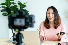 Social media influencer people or content maker concept in relax casual style at home. Young attractive asian woman blogger or vlogger looking at camera and royalty free stock photography