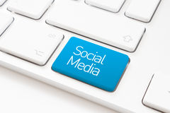 Social media. Key on a white keyboard Stock Image