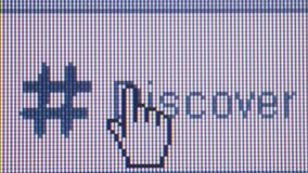 Social Media Macro Close Up (with DOLLY): 'Discover' and cursor. Macro close up of synchronized computer monitor showing :: macro CU of user / cursor pointing stock footage