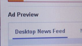 Social Media Macro Close Up: Facebook 'Promote Page'. Macro close up of synchronized computer monitor showing: => Close up of Facebook 'promote page' button stock video footage