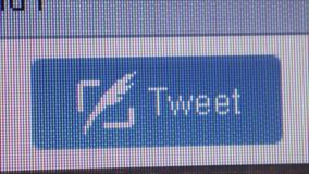 Social Media Macro Close Up: Wider Tweet button with dolly. Macro close up of synchronized computer monitor showing ::  wider shot of Tweet button with user / stock footage