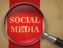 Social Media through Magnifying Glass. Royalty Free Stock Photography