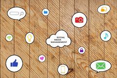 Social media management icons on a wooden background royalty free stock photography