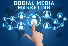 Social Media Marketing. Concept with hand pressing social icons on blue world map background Royalty Free Stock Photos