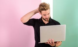 Social media marketing expert. Man with laptop works as smm expert. Guy stylish modern appearance manager producing. Content for social networks. Smm manager royalty free stock photo