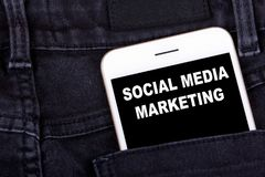 Social media marketing. Smartphone in jeans pocket. Technology business and advertising campaign development background.  royalty free stock photo
